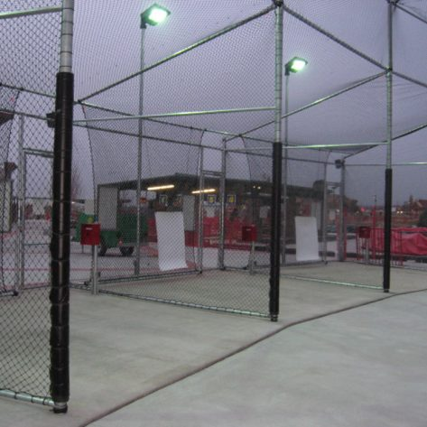 ABC outdoor batting cages with lights on