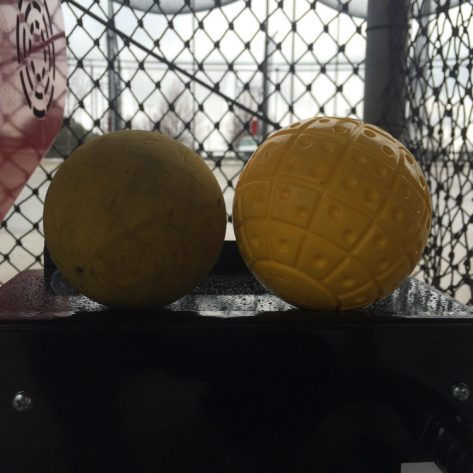 Close up of ABC ball versus normal ball